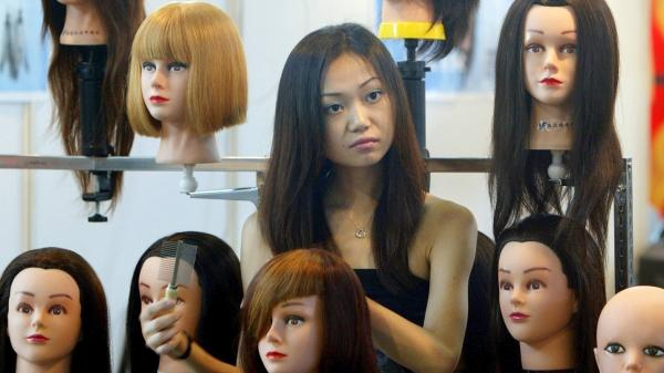 Hairdressers made to run in underwear as punishment